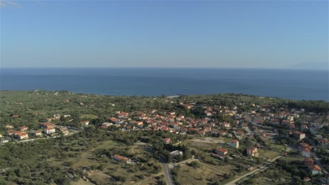 Aerial view of the mountains and the coastline of the suburbs of Alexandroupolis, the northern Greek city of Thrace at summer, during sunset video