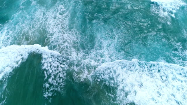 aerial view of the ocean waves splashing - aerial beach stock videos & royalty-free footage