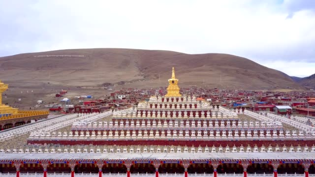 Aerial view of the pagodas with buddhist monks walking under