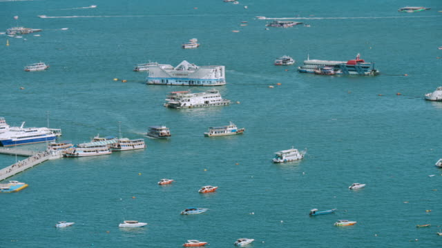 Aerial view of the Pattaya city with the tourist on the dock.
