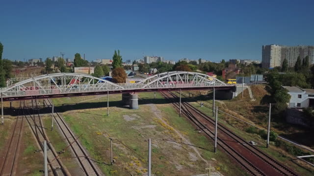 Aerial view of the railway bridge on the background of the railway in the industrial district of the city video