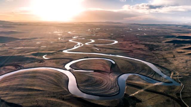 aerial view of the river - timelapse - równina filmów i materiałów b-roll