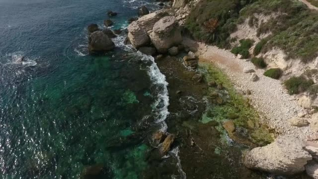 Aerial view of the rocky beach with pieces of rocks near the town of Bonifacio on the island of Corsica