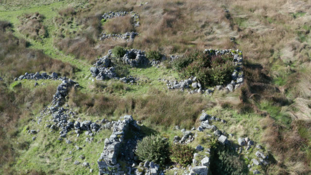 Aerial view of the ruins of an old house in remote countryside