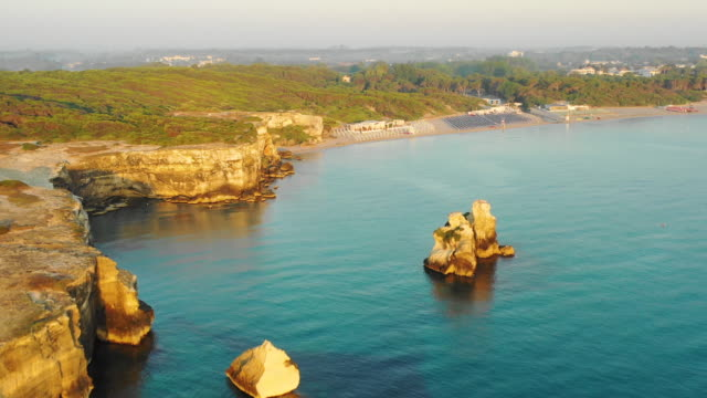 aerial view of the sea and cliffs at sunrise - lecce video stock e b–roll