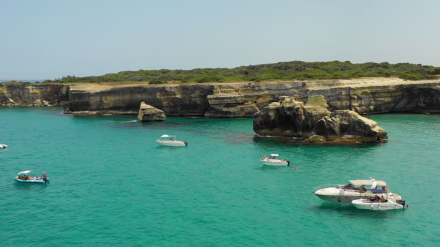 aerial view of the sea, boats and cliffs - lecce video stock e b–roll