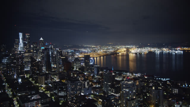 Aerial View of the Seattle Skyline and Puget Sound (Elliott Bay) at Night