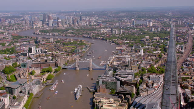 aerial view of the shard, the river thames and tower bridge, uk. 4k - london architecture stock videos & royalty-free footage