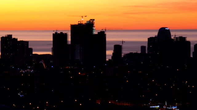 Aerial view of the Silhouettes of Skyscrapers against the Sunset in the Big City