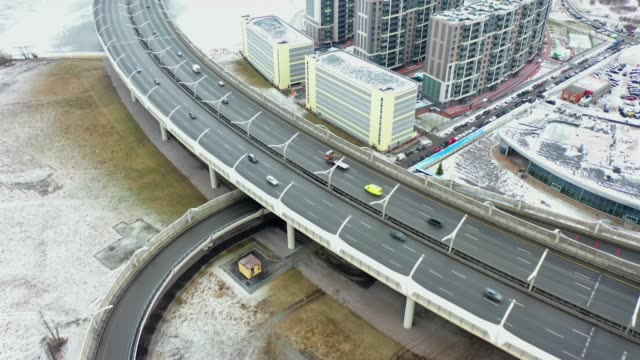 aerial view of the sleeping area of the city, at home and expressway - ghiaccio galleggiante video stock e b–roll