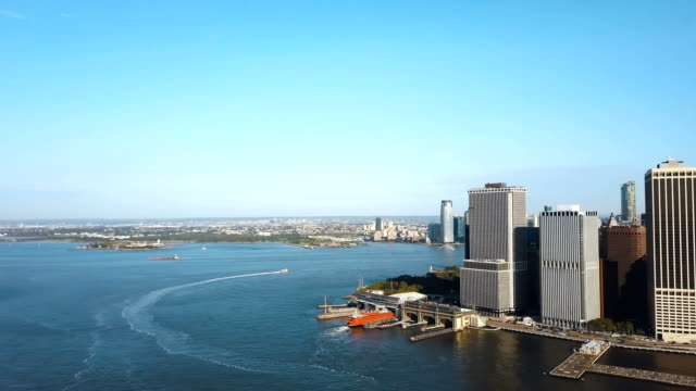 Aerial view of the Statue of liberty in the distance, Manhattan, East river in Manhattan in New York, America video