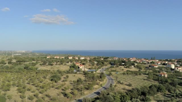 Aerial view of the suburbs, a local road and the coastline of the city of Alexandroupolis, the northern Greek city of Thrace at summer video