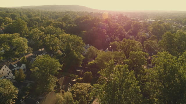 Aerial view of the sunrise in the suburban areas in Millburn, New Jersey, USA. Drone-made video footage with the panoramic camera motion.