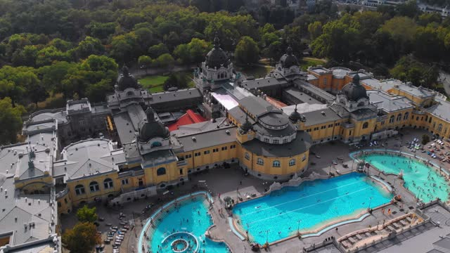 Aerial view of the Szechenyi Thermal Bath Aerial drone view of the famous Szechenyi Thermal Bath and Spa on a sunny autumn day in Budapest, Hungary. hungary stock videos & royalty-free footage