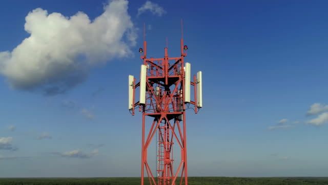 Aerial view of the telecom tower against blue sky video