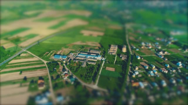 Aerial view of the village during summer time. 4K.