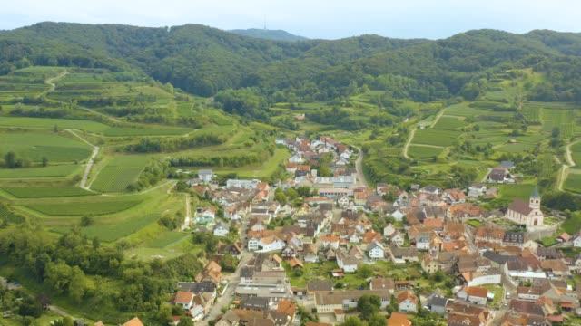 aerial view of the village kiechlinsbergen am kaiserstuhl in germany - barocco video stock e b–roll