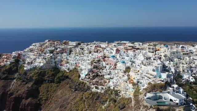 aerial view of the volcanic island of santorini in the mediterranean. - morze egejskie filmów i materiałów b-roll