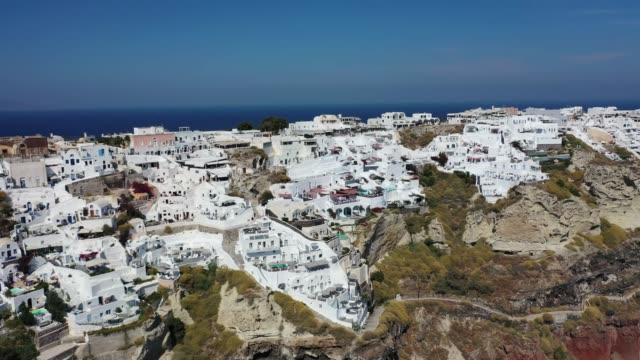 Aerial view of the volcanic island of Santorini in the Mediterranean. Aerial view of the volcanic island of Santorini in the Mediterranean. aegean sea stock videos & royalty-free footage