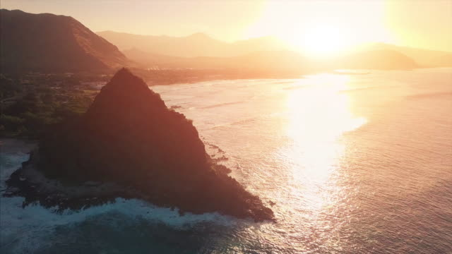 Aerial view of the west coast of the island of Oahu Aerial view of the west coast of the island of Oahu during sunrise oahu stock videos & royalty-free footage