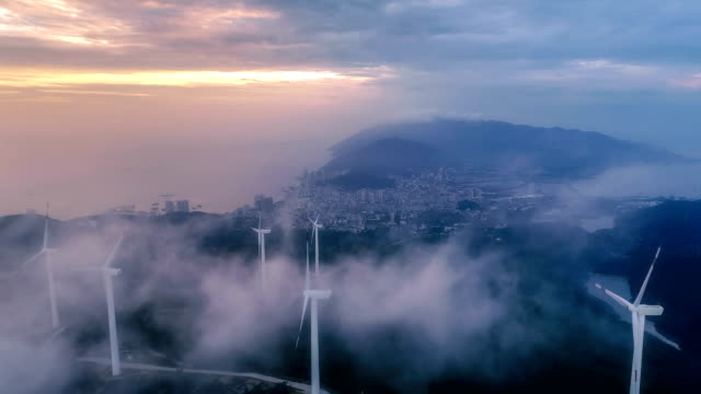 aerial view of the windmill in fog - sustainability video stock e b–roll