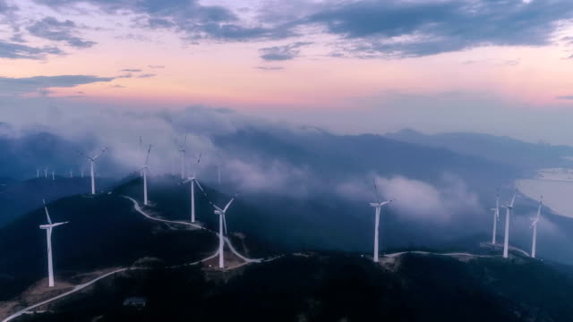 aerial view of the windmill in fog - turbina a vento video stock e b–roll