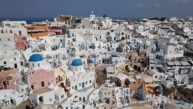 Aerial view of Three Blue Domes church in Oia town on Santorini island, Greece