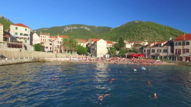 Aerial view of tourists on beach at Komiza, Croatia video