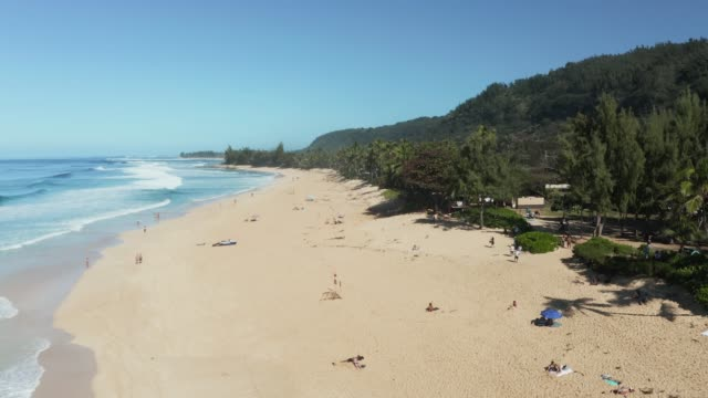 Aerial view of tourists on the Banzai Pipeline beach on North Shore of Oahu - video