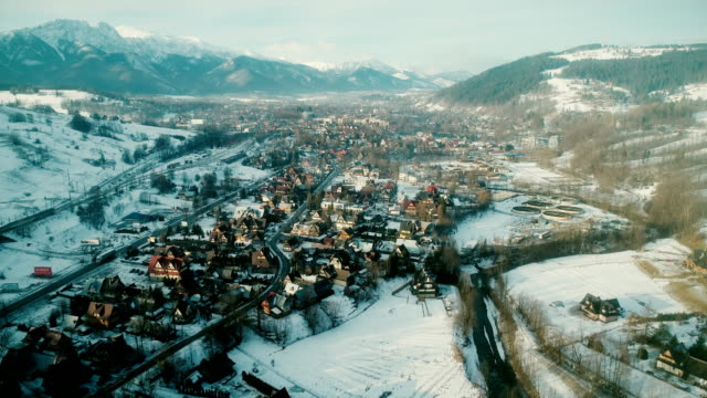 Aerial view of town in mountains in winter video