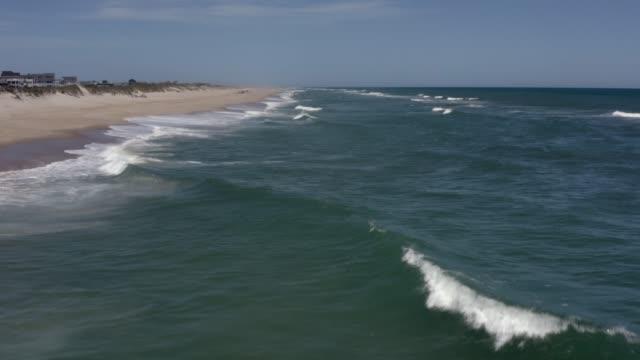 Aerial view of town, ocean and beach. 4k