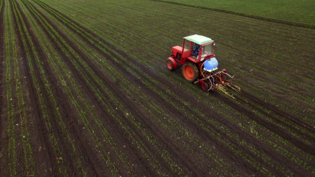Aerial view of tractor sprays fertilizers video