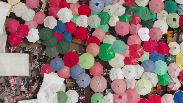 Aerial View of Traditional Food Bazaar in Turkey Aerial view of colorful parasols and market stalls. turkish culture stock videos & royalty-free footage