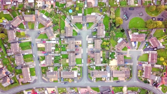 vídeos de stock e filmes b-roll de aerial view of traditional housing estate in england. - vertical