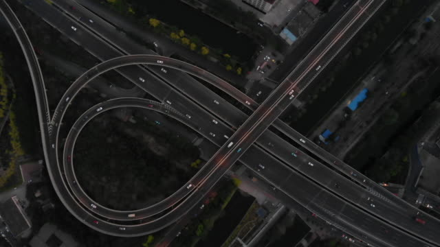 Aerial View of Traffic and Road Intersection at Rush Hour