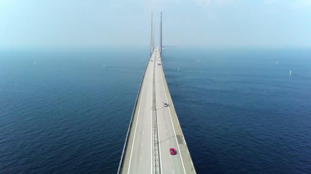aerial view of traffic crossing oresund bridge - most konstrukcja wzniesiona przez człowieka filmów i materiałów b-roll