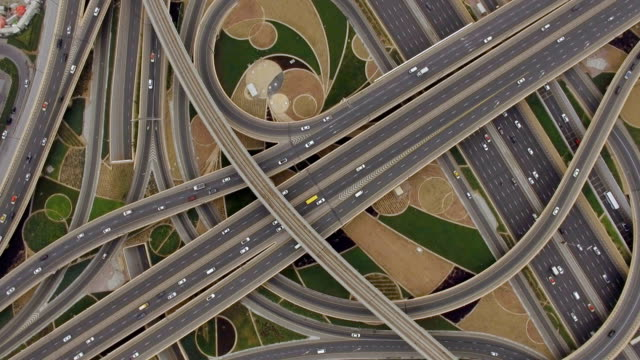aerial view of traffic junction with cars in dubai, uae - dubai video stock e b–roll