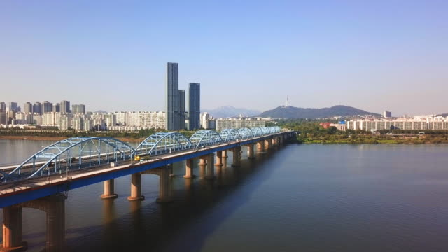 Aerial view of traffic of car driving on Dongjak bridge cross over Han river into N Seoul Tower in Seoul city, South Korea Aerial view of traffic of car driving on Dongjak bridge cross over Han river into N Seoul Tower in Seoul city, South Korea namsan seoul stock videos & royalty-free footage