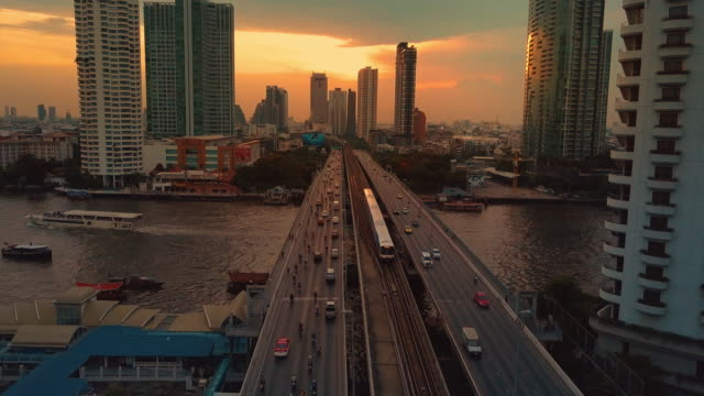 Aerial view of traffic on bridge at sunset video