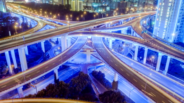 aerial view of traffic on freeway interchange at night. 4K UHD timelapse video