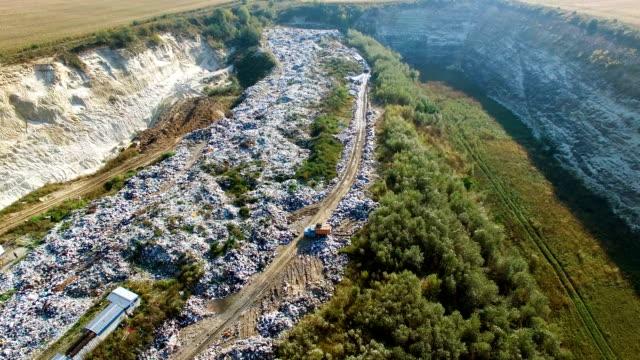 Aerial view of trash dump beetween agricultural fields video