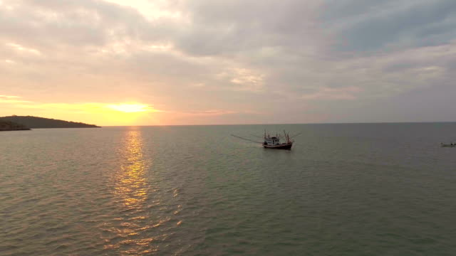 Aerial view of tropical island and tranquil sea at sunrise video