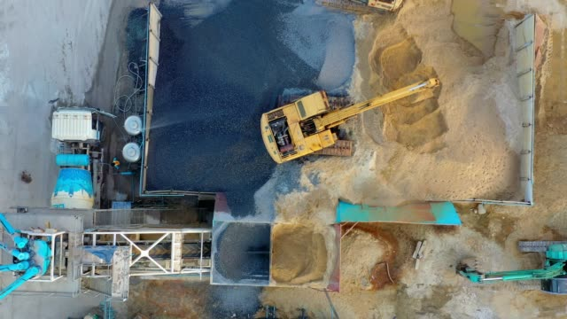 Aerial view of Truck mixer stands on site and Excavator of the concrete plant Aerial view of Truck mixer stands on site and Excavator of the concrete plant in construction site foundation make up stock videos & royalty-free footage