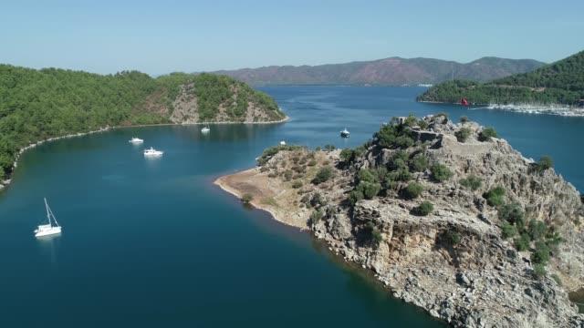 Aerial view of Turkish Flag and 'Kiz kumu' beach/Mugla Mugla/Turkey 11/20/2019 Aerial view of Turkish Flag and 'Kiz kumu' beach/Mugla Mugla/Turkey 11/20/2019 aegean sea stock videos & royalty-free footage