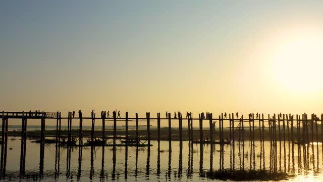 Aerial view of U Bein bridge. U Bein bridge, Mandalay, Myanmar. Aerial view of the oldest and longest teakwood bridge in the world. ancient architecture stock videos & royalty-free footage