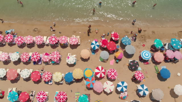 Aerial View of Umbrellas in a Beach of Aegean Sea