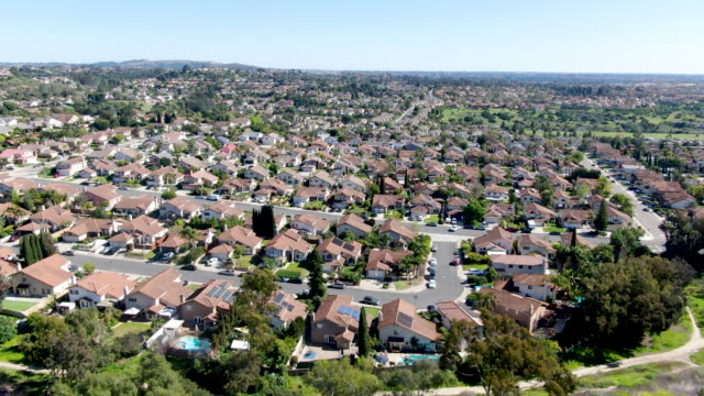 Aerial view of upper middle class neighborhood in the valley with blue sky