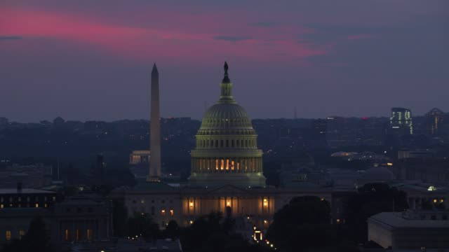 Aerial view of US Capitol Building at dusk.
