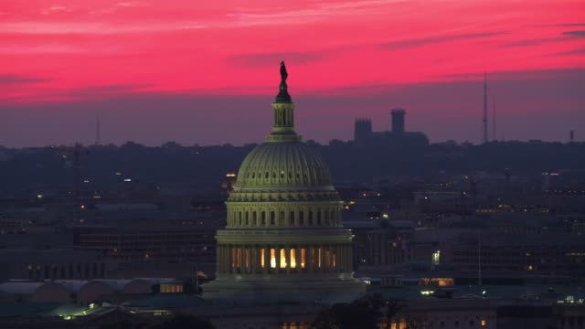 aerial view of us capitol dome at sunset. - capitello video stock e b–roll