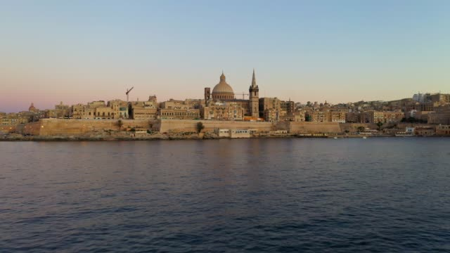 Aerial view of Valletta city. Malta. Evening, dusk, sunset time. Camera forward and up Aerial view of Valletta city. Malta. Evening, dusk, sunset time. Camera forward and up malta stock videos & royalty-free footage